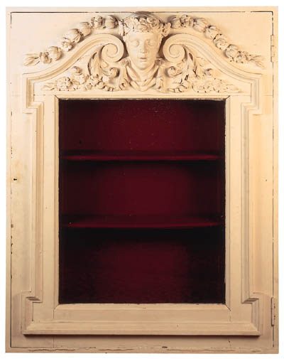 A white painted display cabine