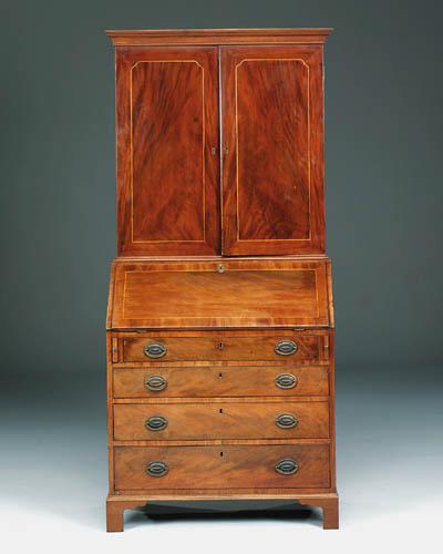 A mahogany and boxwood lined b
