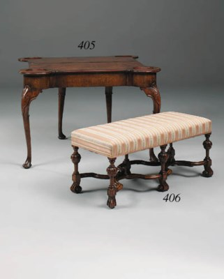 A walnut and upholstered stool