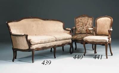 A Louis XV walnut fauteuil