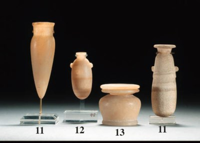 AN ALABASTER KOHL-POT AND LID