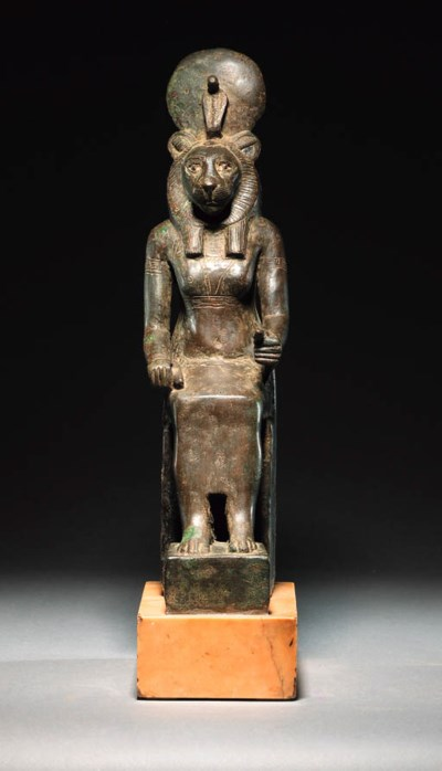 A BRONZE SEATED FIGURE OF THE