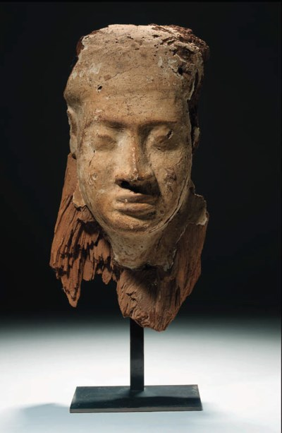 A GESSO-PAINTED WOODEN ANTHROP