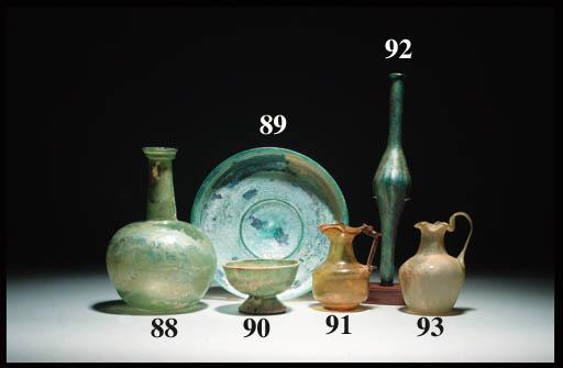 A ROMAN PALE GREEN GLASS JUG