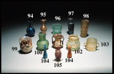 A ROMAN OLIVE GREEN GLASS JAR