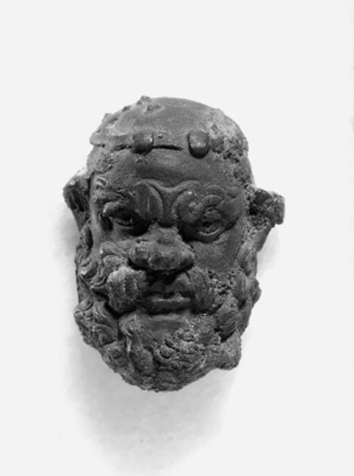 A GRAECO-ROMAN BRONZE MASK OF