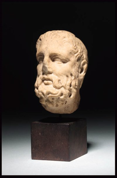 A GRAECO-ROMAN MARBLE HEAD OF