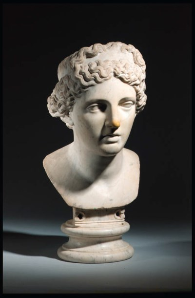 A ROMAN MARBLE HEAD OF APHRODI