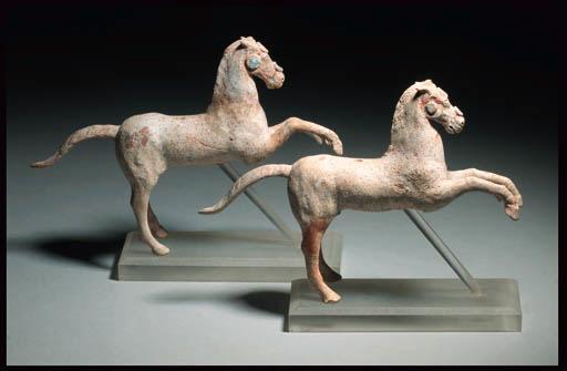 TWO CANOSAN TERRACOTTA HORSES
