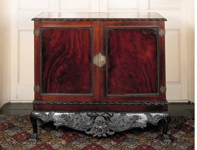 An Irish mahogany cabinet-on-s