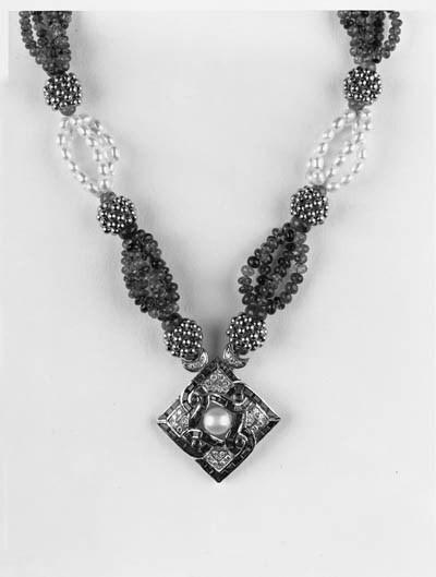 A diamond and gem pendant neck