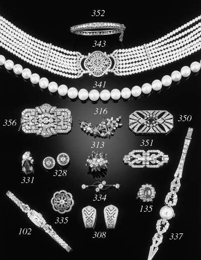 A diamond seven stone brooch