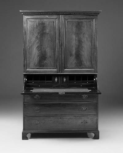 A mahogany secretaire linen pr