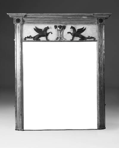 A carved giltwood, ebonised an