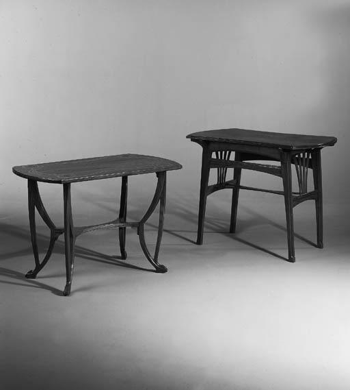 An Art Nouveau walnut side table