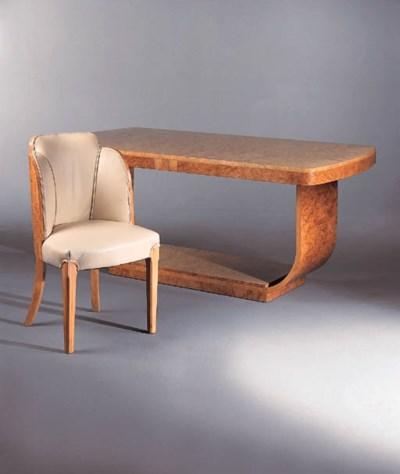 An Art Deco burr-elm dining su