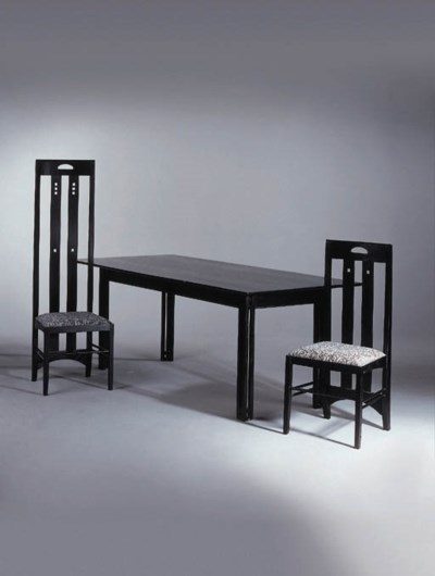 An ebonised dining suite