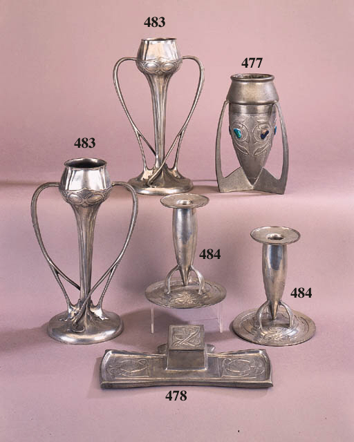 A pair of Liberty English Pewter candlesticks