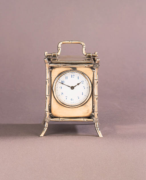 An Arts and Crafts silver mantle clock