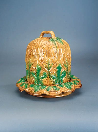 A majolica cheese bell and sta