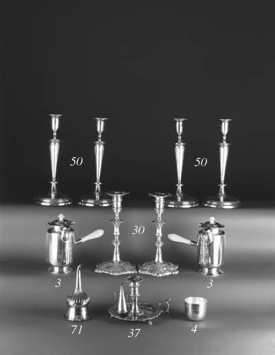 Royal Association: a pair of George II cast candlesticks,
