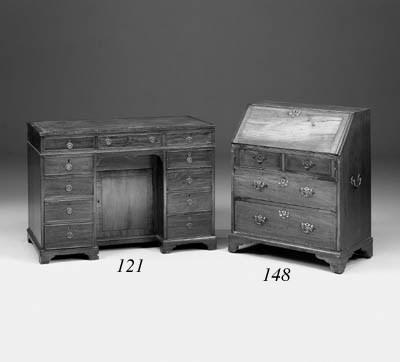 A mahogany kneehole desk, earl