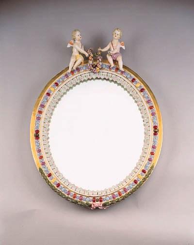 A Meissen oval mirror frame