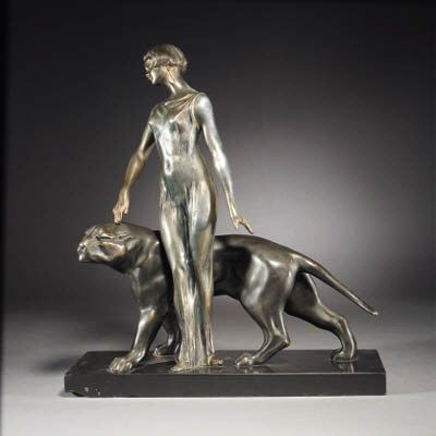 A patinated spelter figure gro