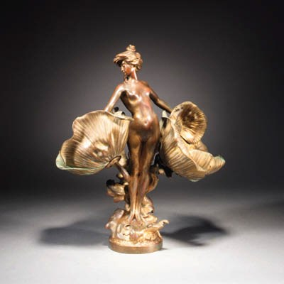 A gilt patinated bronze figure