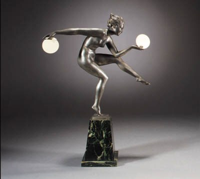 A silvered spelter and faux iv