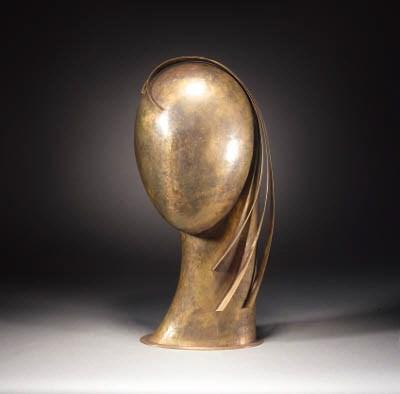 A Hagenauer patinated brass ma