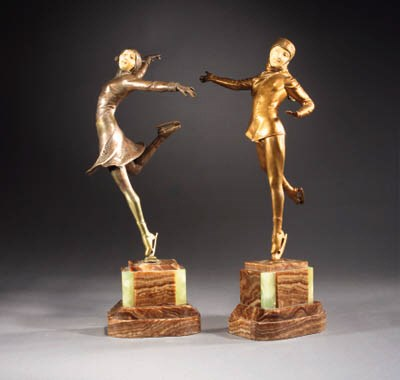 A pair of gilt bronze and ivor