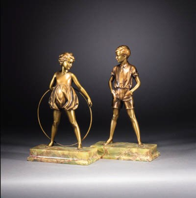 A pair of gilt patinated bronz