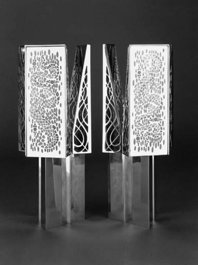 A pair of modern candleholders