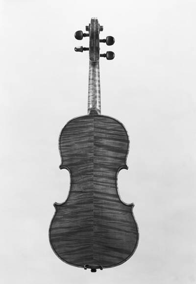 A violin, labelled Piero Badal