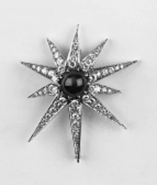 A diamond and star ruby brooch