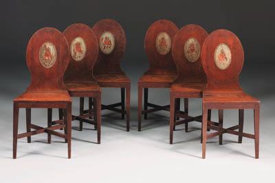 A set of six George III oak armorial hall chairs
