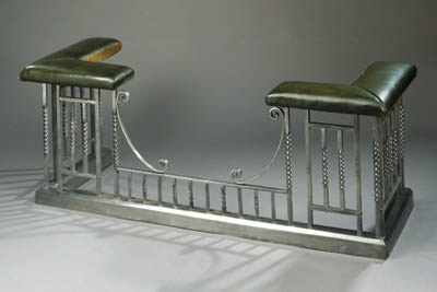 A polished cast iron club fend