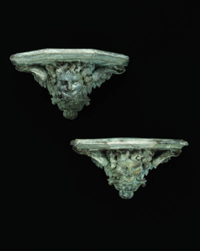 A set of four bronze wall brac