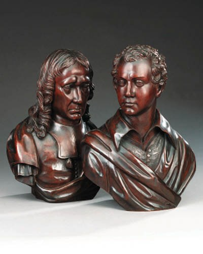 A pair of carved and stained w