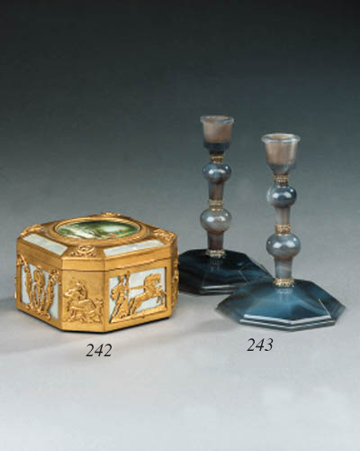 A pair of silver mounted agate candlesticks, early 20th century