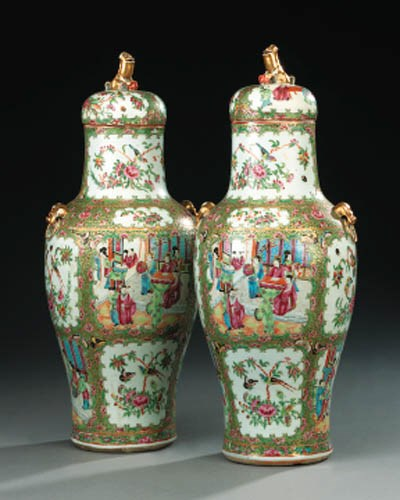 A pair of famille rose urns wi