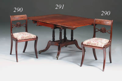 A Regency mahogany and rosewood crossbanded extending drop-flap dining table