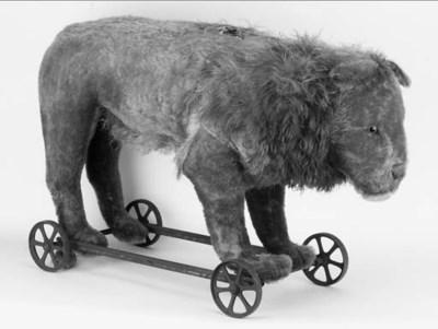 Steiff lion on wheels