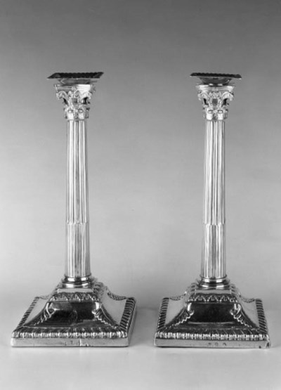 A PAIR OF GEORGE II CANDLESTIC