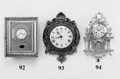 A giltwood wall timepiece, 20t