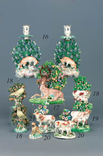 A pair of Derby candlestick gr