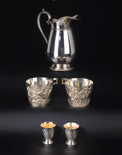A pair of Greek silver cups, a