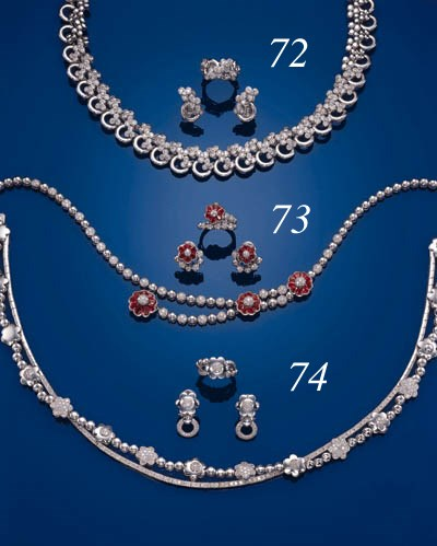 A SUITE OF RUBY, DIAMOND AND 1