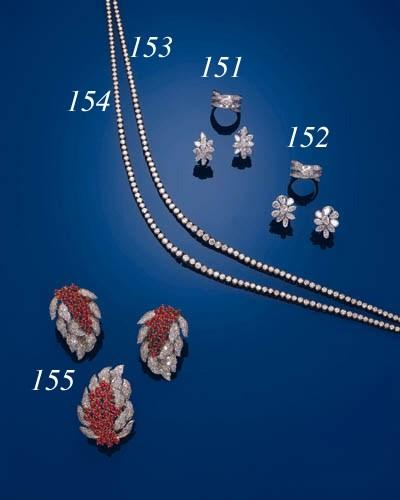 A SINGLE-STONE DIAMOND RING AN